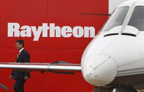 A man walks past the Raytheon exhibition during the Australian International Airshow in Melbourne in this March 2, 2011 file photo. REUTERS/