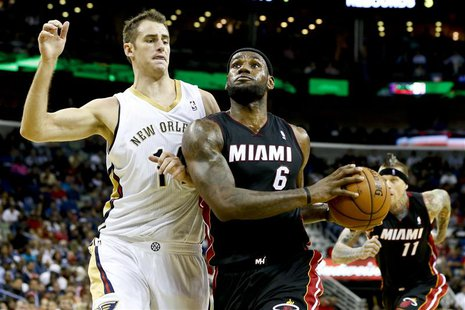 Oct 23, 2013; New Orleans, LA, USA; Miami Heat small forward LeBron James (6) drives past New Orleans Pelicans power forward Jason Smith (14