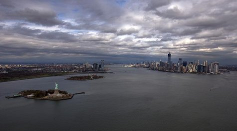 The Statue of Liberty, Liberty Island and Ellis Islands are seen to the left next to New York's Lower Manhattan skyline in this aerial image