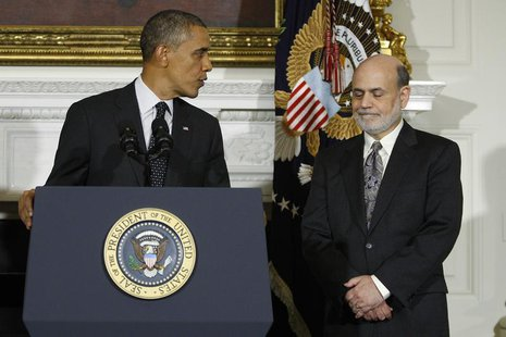 U.S. President Barack Obama (L) thanks Federal Reserve Chairman Ben Bernanke (R) for his service as he announces his nomination of Janet Yel