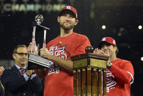 Oct 18, 2013; St. Louis, MO, USA; St. Louis Cardinals starting pitcher Michael Wacha holds the series MVP trophy after game six of the Natio
