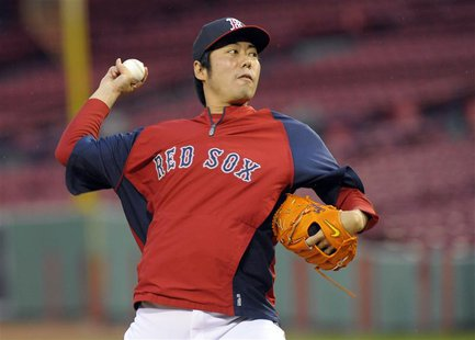 Oct 22, 2013; Boston, MA, USA; Boston Red Sox relief pitcher Koji Uehara (19) throws a pitch during workouts the day before game one of the
