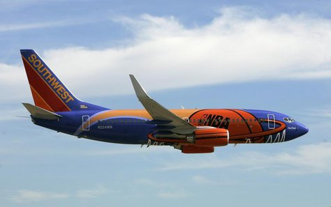 A Southwest Airlines passenger aircraft painted with a new NBA logo theme arrives at Love Field airport for a news conference in Dallas, Tex