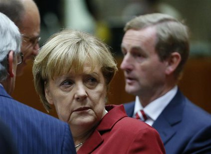 Germany's Chancellor Angela Merkel (L) and Ireland's Prime Minister Enda Kenny (R) attend a European Union leaders summit in Brussels Octobe