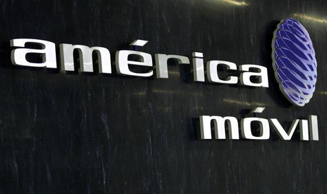 The logo of America Movil is seen on the wall of the reception area in the company's new corporate offices in Mexico City February 8, 2011.
