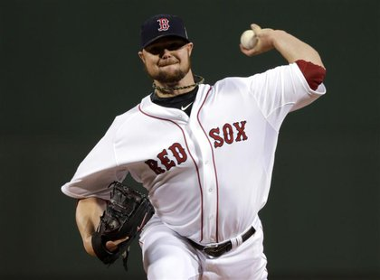 Oct 23, 2013; Boston, MA, USA; Boston Red Sox starting pitcher Jon Lester throws a pitch against the St. Louis Cardinals in the first inning