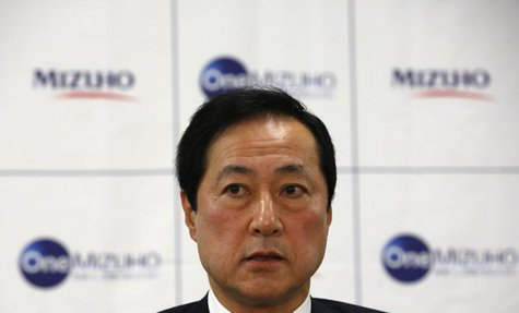 Mizuho Financial Group President and CEO Yasuhiro Sato speaks during a news conference on the merging of Mizuho Bank and Mizuho Corporate Ba