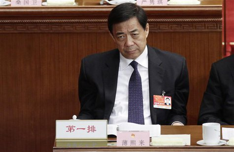 Former China's Chongqing Municipality Communist Party Secretary Bo Xilai pauses as he attends a plenary meeting of China's parliament, the N