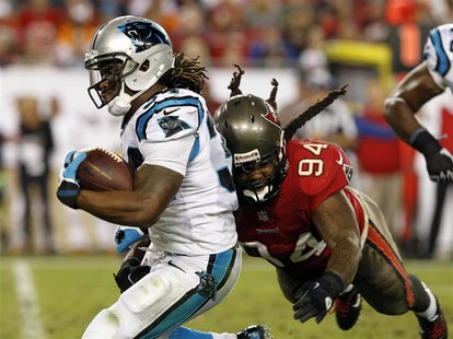 Oct 24, 2013; Tampa, FL, USA; Carolina Panthers running back DeAngelo Williams (34) runs with the ball as Tampa Bay Buccaneers defensive end