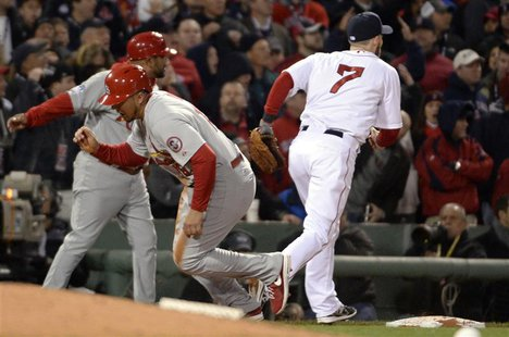 Oct 24, 2013; Boston, MA, USA; St. Louis Cardinals center fielder Jon Jay (19) gets up and runs home to score a run after the ball gets away
