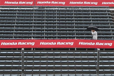 A MotoGP fan walks in the stands at the Twin Ring Motegi circuit ahead of Sunday's Japanese Grand Prix in Motegi, north of Tokyo October 25,