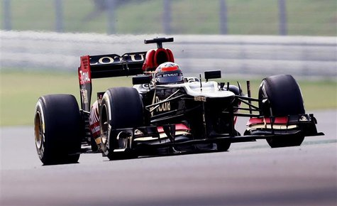 Lotus F1 Formula One driver Kimi Raikkonen of Finland drives during the first practice session of the Indian F1 Grand Prix at the Buddh Inte