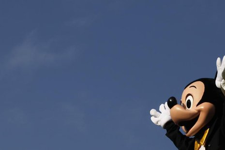 A person dressed as Mickey Mouse waves during a musical parade at Hong Kong Disneyland November 4, 2009. REUTERS/Tyrone Siu