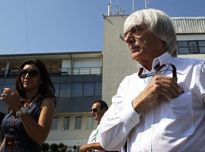 Formula One supremo Bernie Ecclestone (R) is pictured during the third practice session of the Hungarian F1 Grand Prix at the Hungaroring ci