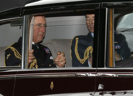 Britain's Prince Charles (L) arrives for the christening of Prince George at St James's Palace in London October 23, 2013. REUTERS/Olivia Ha