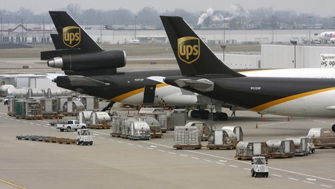 United Parcel Service aircraft are loaded with air containers full of packages bound for their final destination at the UPS Worldport All Po