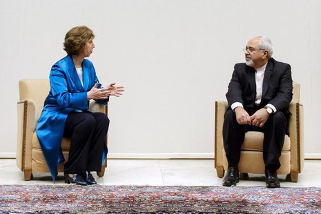 European Union foreign policy chief Catherine Ashton (L) speaks with Iranian Foreign Minister Mohammad Javad Zarif during a photo opportunit