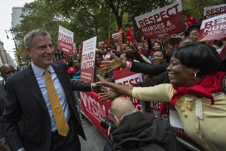 Democratic New York City mayoral candidate Bill de Blasio (L) is greeted by supporters during the New York State Nurses Association rally ou