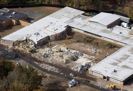 Demolition work is underway at Sandy Hook Elementary School in Newtown, Connecticut October 25, 2013. REUTERS/Michelle McLoughlin