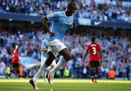 Manchester City's Yaya Toure celebrates scoring against Manchester United during their English Premier League soccer match at the Etihad Sta
