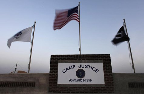 Flags wave above the sign posted at the entrance to Camp Justice, the site of the U.S. war crimes tribunal compound, at Guantanamo Bay U.S.