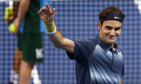 Switzerland's Roger Federer waves after winning his quarter final match against Grigor Dimitrov of Bulgaria at the Swiss Indoors ATP tennis