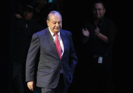 Mexican billionaire Carlos Slim walks on stage for an event of the Fundacion Telmex Mexico Siglo XXI (Telmex Foundation Mexico XXI Century)