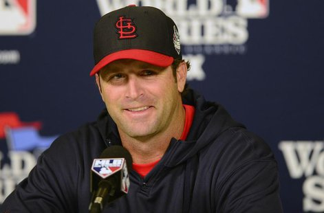 St. Louis Cardinals manager Mike Matheny (22) talks with the media during a press conference a day before game three of the World Series aga