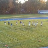 Saugatuck High players prepare prior to their 58-13 win at Gobles on Oct. 25, 2013.