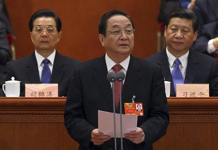 Newly elected chairman of the National Committee of the Chinese People's Political Consultative Conference (CPPCC), Yu Zhengsheng (C), speak