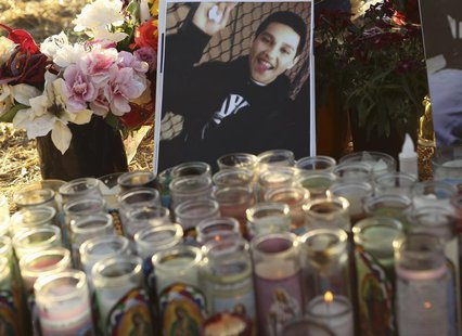 A photo of Andy Lopez Cruz is shown at a makeshift memorial at the site of his death in Santa Rosa, California October 24, 2013. REUTERS/Rob