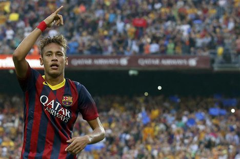 "Barcelona's Neymar celebrates after scoring a goal against Real Madrid during their Spanish first division ""Clasico"" soccer match at Nou Cam"