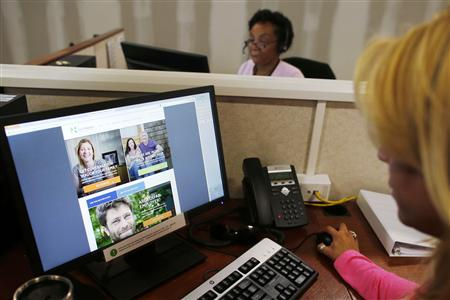 Janet Perez (R) oversees specialists (top) as they help callers and potential customers find health insurance at a customer contact and call center for HealthSource RI, Rhode Island's health insurance exchange program for the Affordable Care Act or ''ObamaCare,'' in Providence, Rhode Island October 25, 2013. Credit: Reuters/Brian Snyder