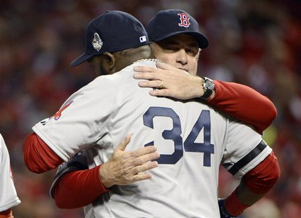Boston Red Sox designated hitter David Ortiz (34) gets a hug from manager John Farrell before game three of the MLB baseball World Series ag