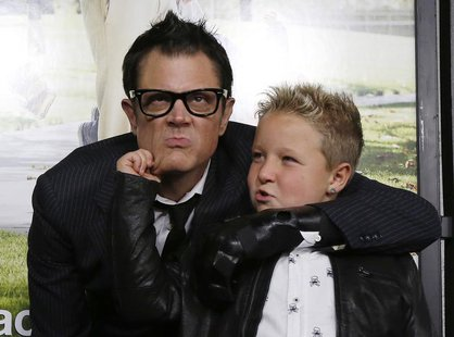 "Cast member Johnny Knoxville (L) poses with co-star Jackson Nicoll at the premiere of ""Jackass Presents: Bad Grandpa"" in Hollywood, Californ"