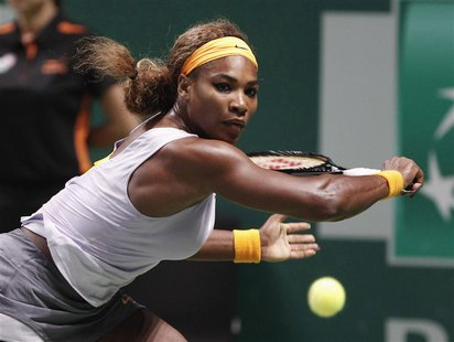 Serena Williams of the U.S. hits a return to Li Na of China during their WTA tennis championships final match at Sinan Erdem Dome in Istanbu
