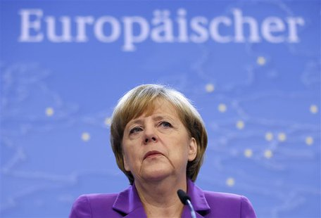 Germany's Chancellor Angela Merkel addresses a news conference during a European Union leaders summit in Brussels October 25, 2013. REUTERS/