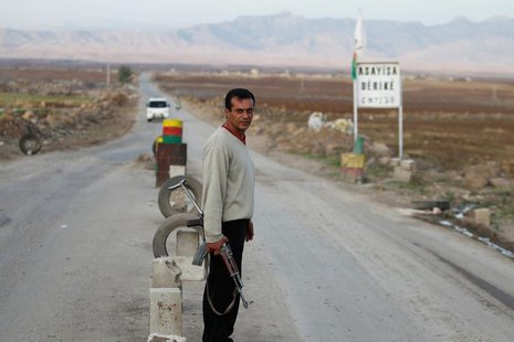 A Syrian Kurd Asaish stands at a security checkpoint at Derik in Al-Hasakah October 31, 2012. REUTERS/Thaier al-Sudani