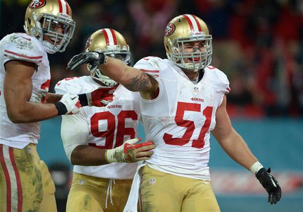 San Francisco 49ers outside linebacker Dan Skuta (51) celebrates with teammates including Corey Lemonier (96) after scoring a touchdown on a