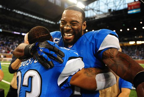Detroit Lions wide receiver Calvin Johnson (81) celebrates with cornerback Chris Houston (23) after defeating the Dallas Cowboys 31-30 at Fo