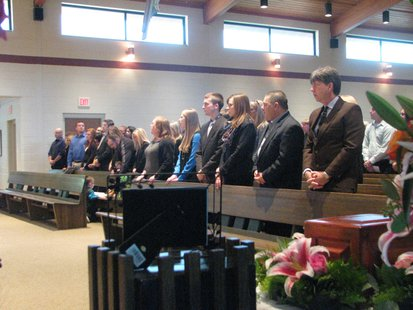 The family of Kira Steger during her funeral service 10/26/13