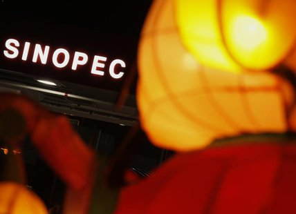 A Sinopec sign displayed at its gas station is seen behind a Chinese New Year lantern installation in Hong Kong February 5, 2013. REUTERS/Bo