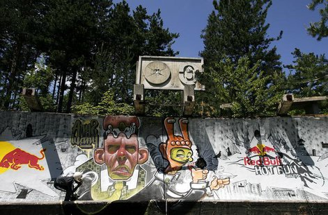 A skater speeds down the former Olympic bobsleigh run at Trebevic hill near Sarajevo during the Red Bull Hot Run race May 31, 2008. REUTERS/