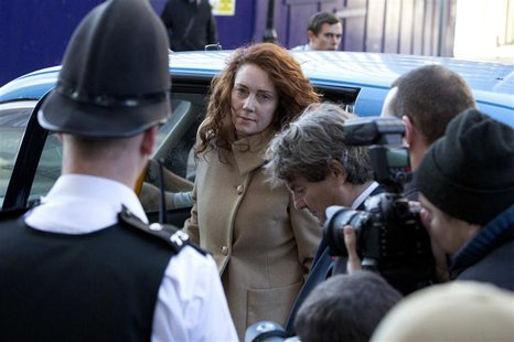 Former News International chief executive Rebekah Brooks arrives with her husband Charlie at the Old Bailey courthouse in London October 28,