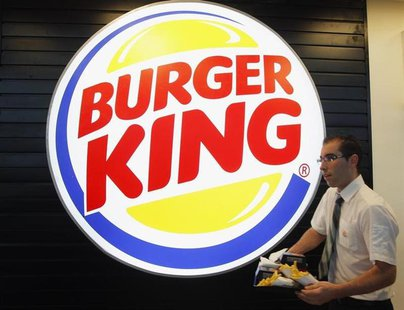 An employee prepares a food order on the opening day of the Burger King restaurant at the Marignane airport hall December 22, 2012. REUTERS/
