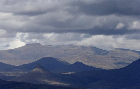 Rain clouds hang over the Karoo near Graaff-Reinet October 26, 2013. REUTERS/Mike Hutchings