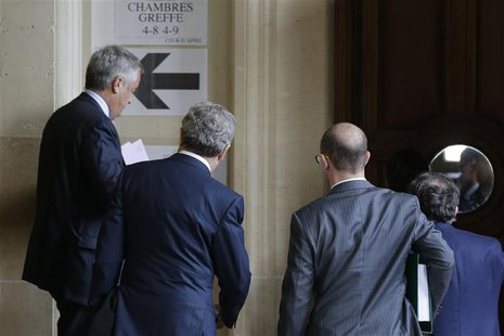 Former Vivendi head Jean-Marie Messier (L) arrives for the opening of an appeals trial at Paris courts, October 28, 2013. REUTERS/Jacky Naeg