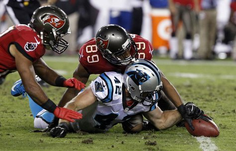 Oct 24, 2013; Tampa, FL, USA; Carolina Panthers defensive back Colin Jones (42) grabs a fumble from Tampa Bay Buccaneers wide receiver Eric