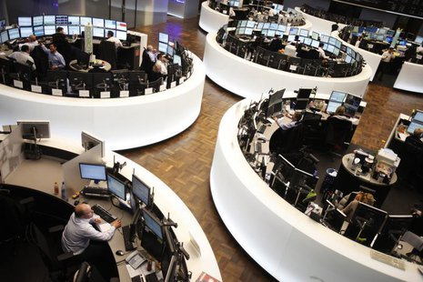 Traders work at their desks at the Frankfurt stock exchange February 1, 2012. REUTERS/Alex Domanski
