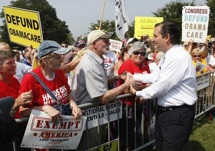 U.S. Senator Ted Cruz (R-TX) (R) greets attendees as he arrives to speak at the Tea Party Patriots 'Exempt America from Obamacare' rally on